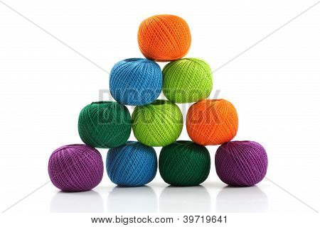 Pyramid Of Yarn For Knitting On A White Background