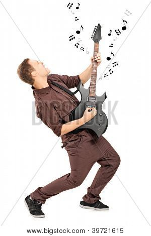 Full length portrait of a rock star playing on a guitar isolated on white background
