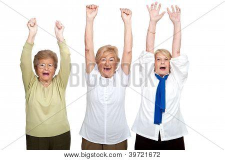 Three Senior Women Raising Hands.