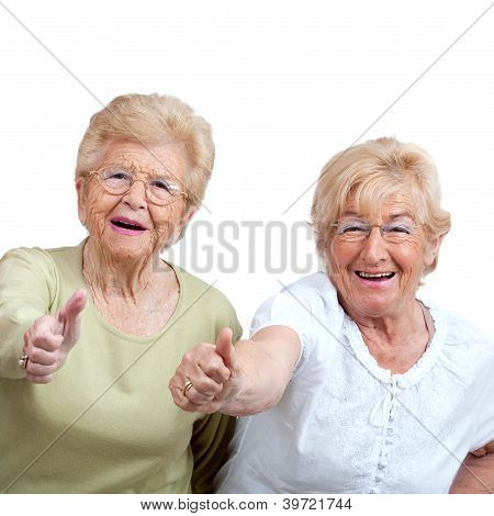 Two Elderly Woman Showing Thumbs Up.