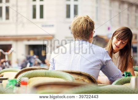 Casual Woman Having A Conversation With Her Date