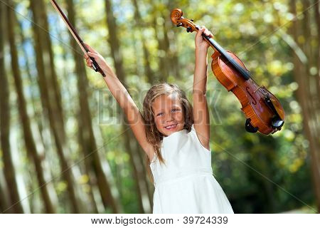 Happy Violinist Raising Violin Outdoors.