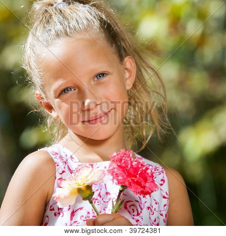 Sweet Girl Holding Flowers Outdoors.