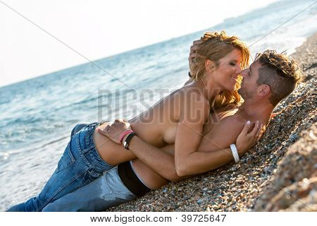 In Love Couple About To Kiss On Beach.