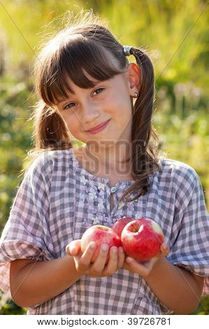 Cute Little Girl With Apple In Hand