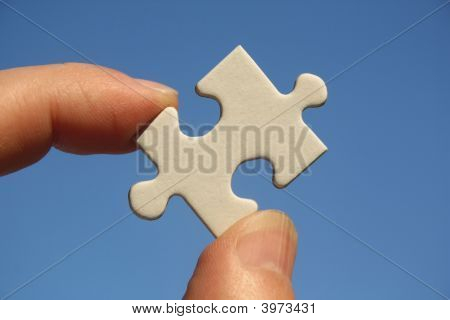 Jigsaw Puzzle In Human Fingers