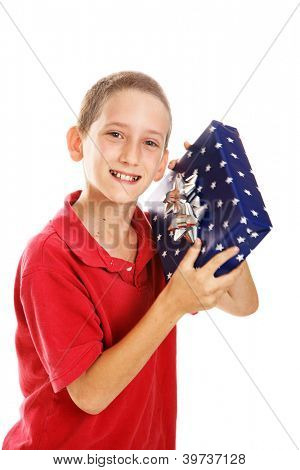 Little boy shaking a gift.  Wrapping could be for Hanukkah or Christmas.  Motion blur on package.  Isolated.