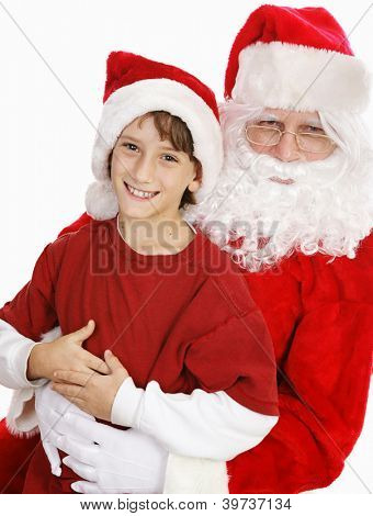 Adorable little boy on Santa's lap, asking for Christmas presents.  White background.