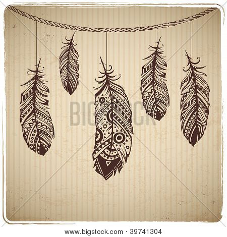 Ethnic feather on the cardboard background