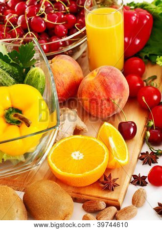 Fresh vegetable and fruit and glass of juice.