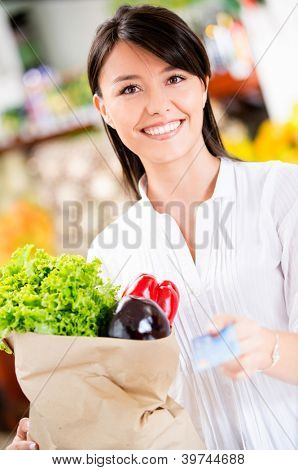 Female customer paying by credit card at the supermarket