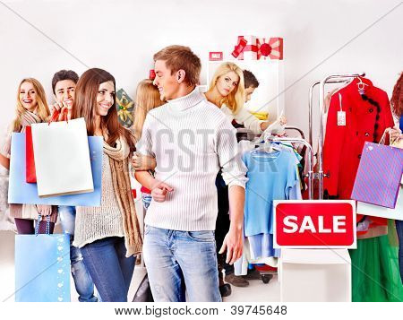 Shopping group people at sales in clothing store.