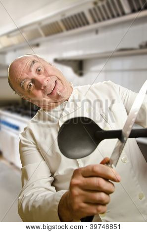 Crazy cook with a spoon and a knife