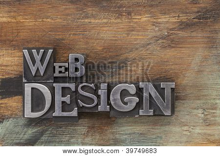 web design - text in vintage letterpress metal type blocks on a grunge painted wood