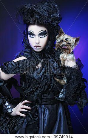 elegant dark queen with little dog