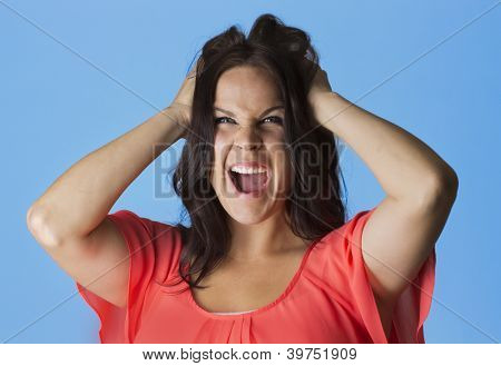 Crazed and Frustrated Woman pulling her hair
