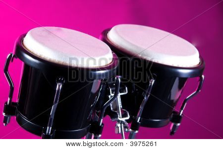 Set Of Black Bongos Isolated Against Pink Background