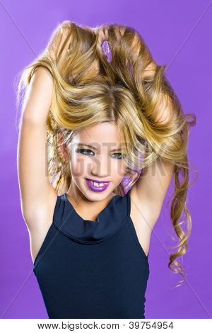Blond children fashiondoll girl fashion makeup on purple background