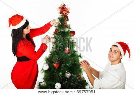 Man and womandecorating Christmas tree