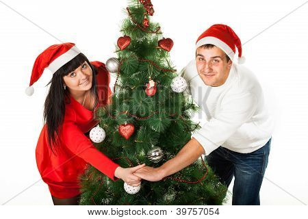 Man and woman looking out of Christmas tree