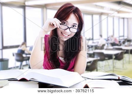 Female Student Reading With Glasses