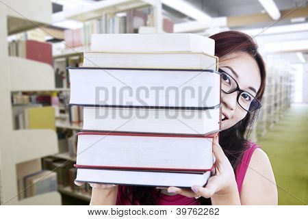 Girl Student Behind Books