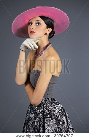 Young stylish woman with purple retro hat