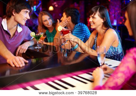 Portrait of joyful friends having party in the bar