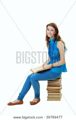 Student Girl Sitting On Pile Of Books
