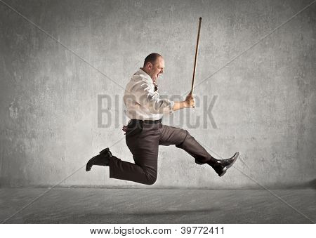 Fat man with a stick running after someone