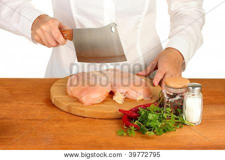 Chef cooking meat on wooden table