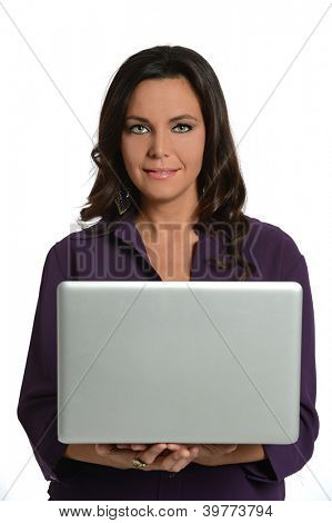 Attractive businesswoman holding laptop isolated over white background