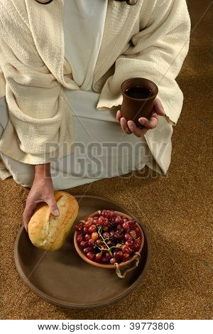 Jesus hands holding communion symbols: bread and wine