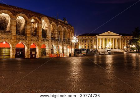 Illuminated Piazza Bra And Ancient Amphitheater In Verona, Veneto, Italy