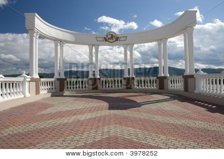 Arch With White Columns.