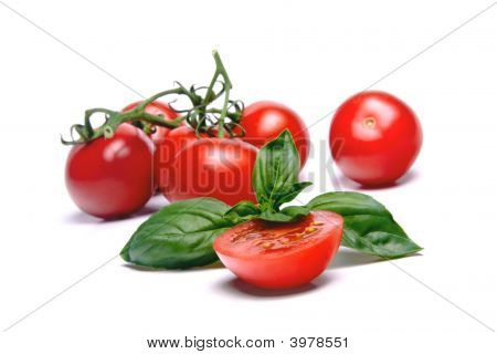 Cherry Tomatoes And Basil Leaf