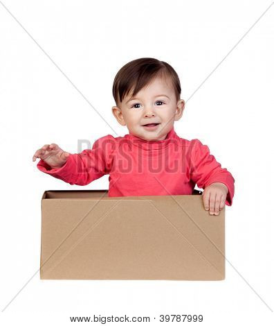 Adorable baby girl in a box isolated on white background