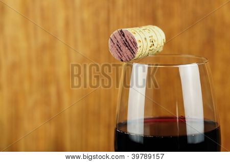 Glass And Cork Of Fine Italian Red Wine