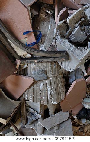 Headless Statue Among Debris