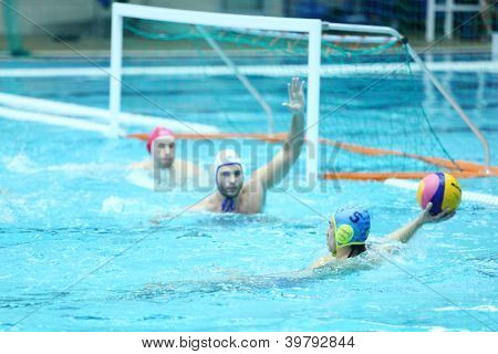 MOSCOW - MARCH 3: Men play water polo in pool at 7th round match of Russian Championship in water polo in Olimpiysky Sports Complex on March 3, 2012 in Moscow, Russia.