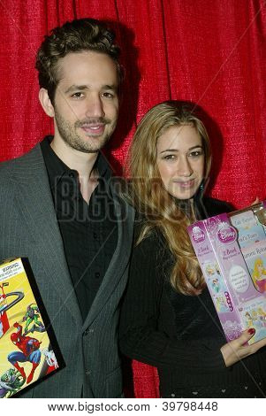 UNIVERSAL CITY - DEC. 4: David Lautman and Lisa Lautman arrive at publicist Mike Arnoldi's birthday celebration & Britticares Toy Drive for Children's Hospital on Dec. 4, 2012 in Universal City, CA.