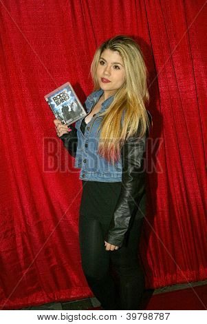 UNIVERSAL CITY - DEC. 4: Casandra Ashe arrives at publicist Mike Arnoldi's birthday celebration & Britticares Toy Drive for Children's Hospital on Dec. 4, 2012 in Universal City, CA.