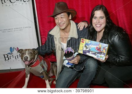 UNIVERSAL CITY - DEC. 4: Liam Stone, Bella the Movie Dog & Allison Burton arrive at publicist Mike Arnoldi's birthday celebration & Britticares Toy Drive on Dec. 4, 2012 in Universal City, CA.