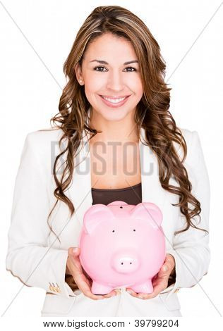 Businesswoman saving money in a piggybank - isolated over white