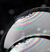 Closeup of soap bubbles. The iridescent colours of soap bubbles are caused by interfering of (intern