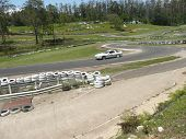 stock photo of skid-steer  - This a special day where the cars have to skid into corners and steer while still skidding around the corners. It was held at Raleigh Raceway which usually runs Go-Karts. 