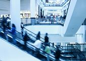 picture of shopping center  - Moving crowd on escalator in modern interior - JPG