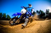 picture of dirt-bike  - Enduro bike rider on action - JPG