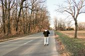 stock photo of kinda  - walking down the road alone and kinda sad - JPG