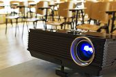 stock photo of cinema auditorium  - Digital projector in a conference hall - JPG